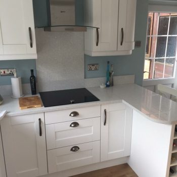 Painted brilliant white fitted kitchen