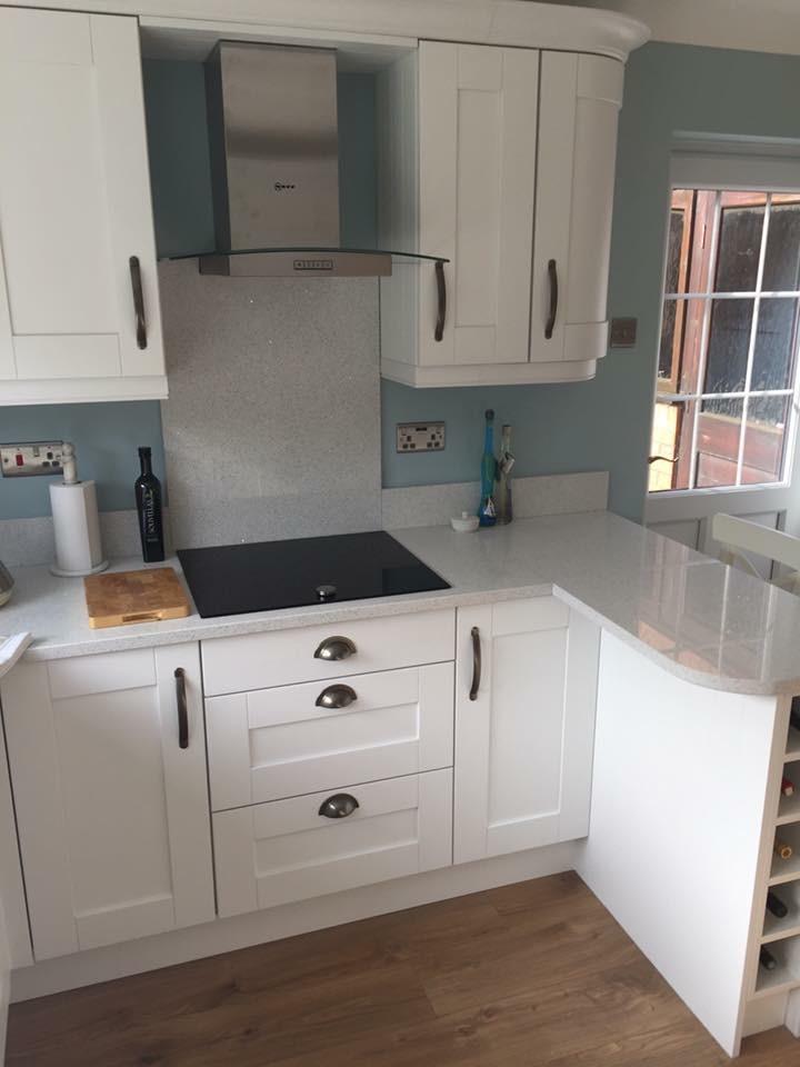 Brilliant White Fitted Kitchen Set Against Duck Egg Blue