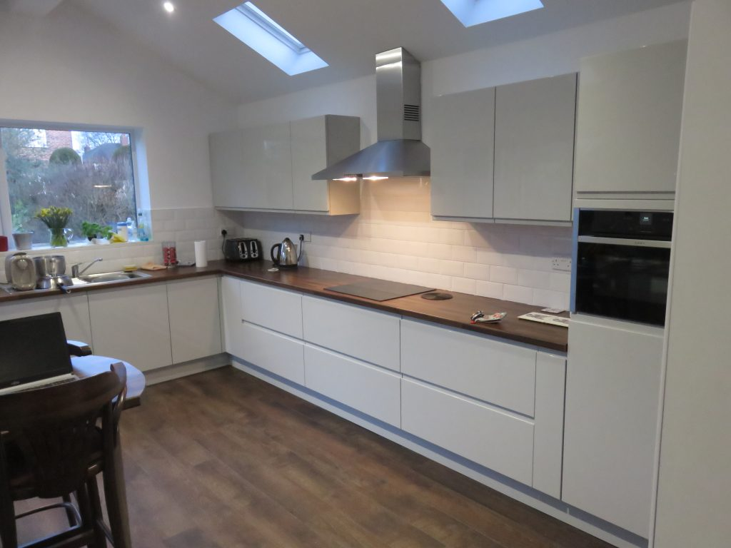 Light grey gloss strada kitchen the gallery fitted kitchens for Light grey modern kitchen