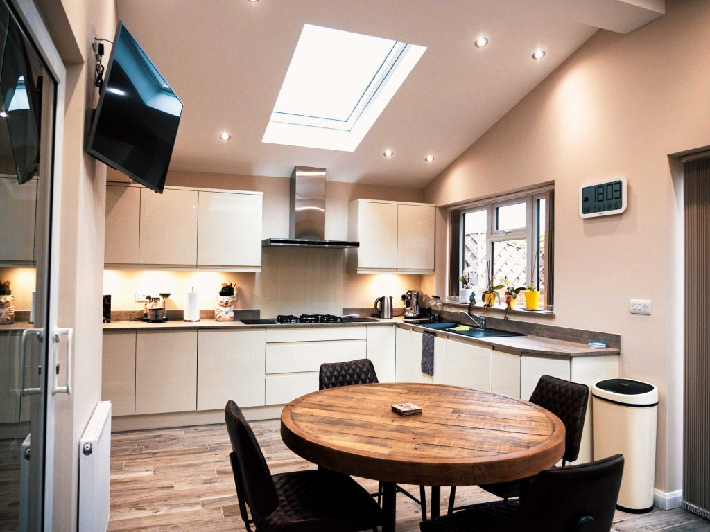 Galley style kitchen - fitted in Kingswinford. Gloss porcelain & handle-less