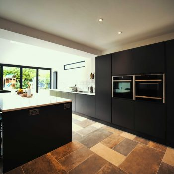 Urban kitchen by The Gallery fitted kitchens | Matte, Graphite, handle-less