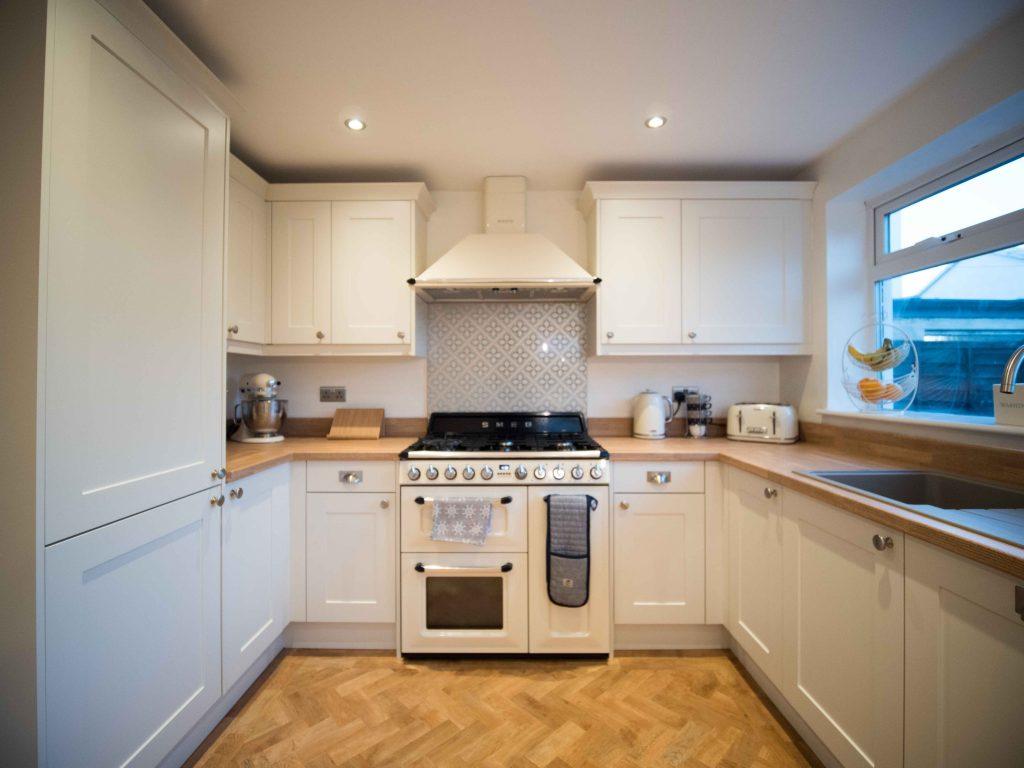 Oak parquet flooring in a beautiful Shaker kitchen